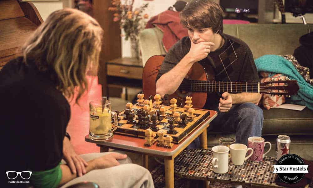 What's your next move? Guests playing chess at Ani&haakien Hostel, 5 Star Hostel in Rotterdam