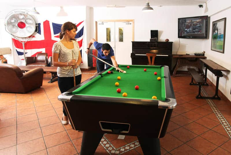 A pool table is a great game to add to your hostel or hotel